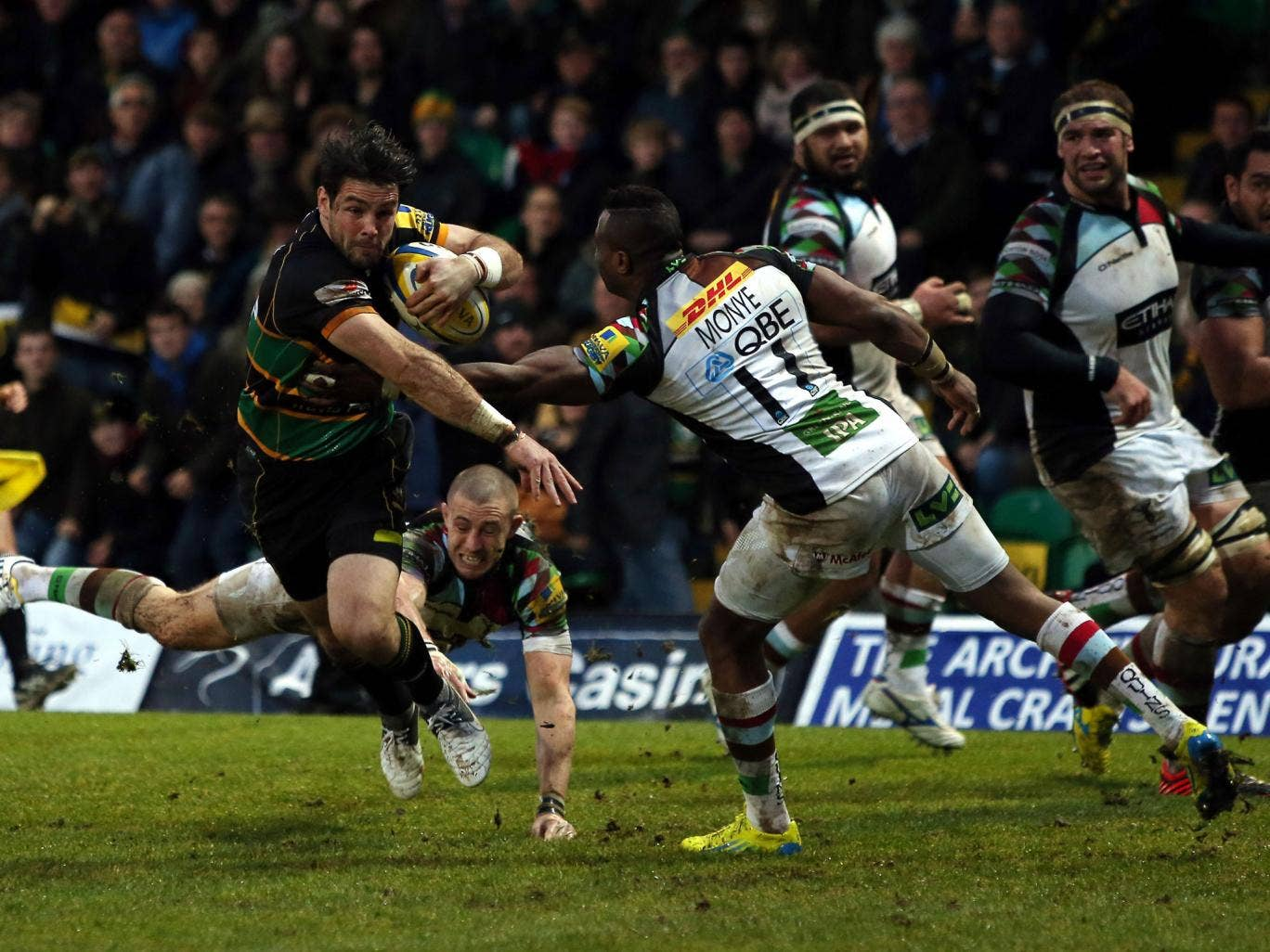 Back breaker Saints' Ben Foden manages to evade Quins' Mike Brown and Ugo Monye, but it was not to be Northampton's day