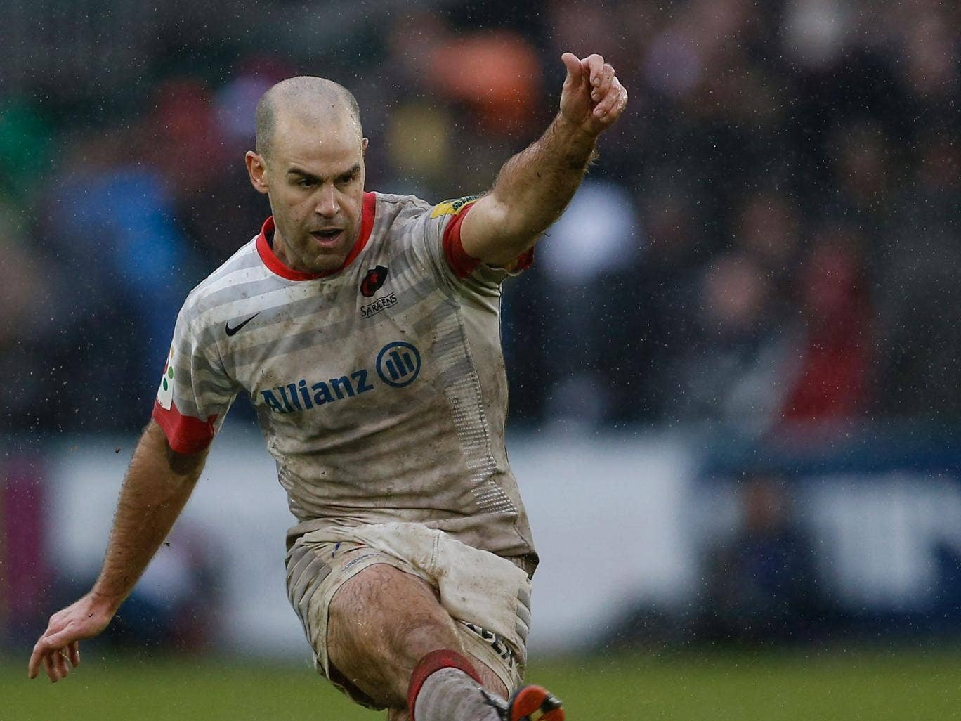 In the swing: Charlie Hodgson of Sarries kicks on his way to 17 points