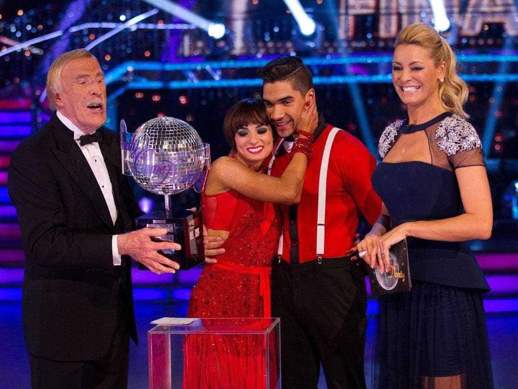 Bruce Forsyth and Tess Daly flanking 'Strictly' winners Flavia Cacace and Louis Smith