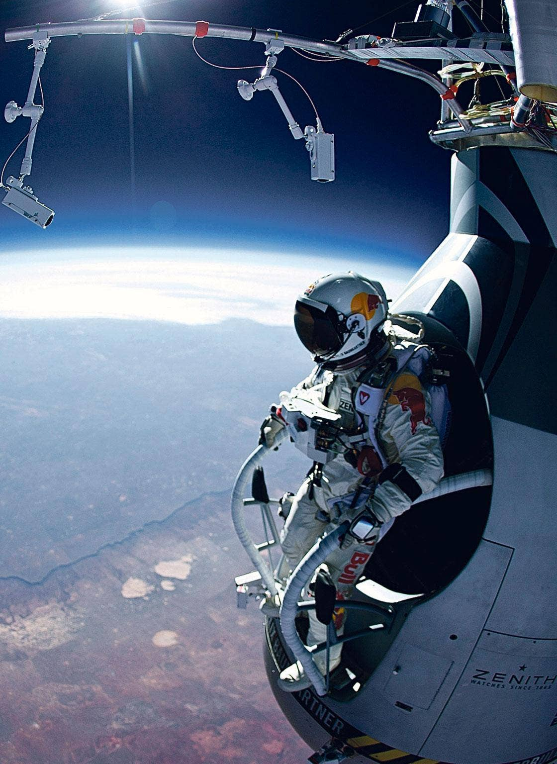 To the nearest mile, how high was Austrian skydiver Felix Baumgartner when he jumped out of his Red Bull Stratos  helium-filled balloon on 14 October?