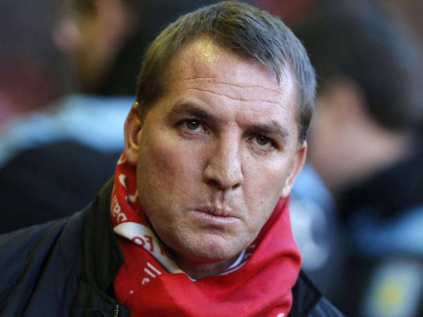 Brendan Rodgers sports a Liverpool scarf against Aston Villa