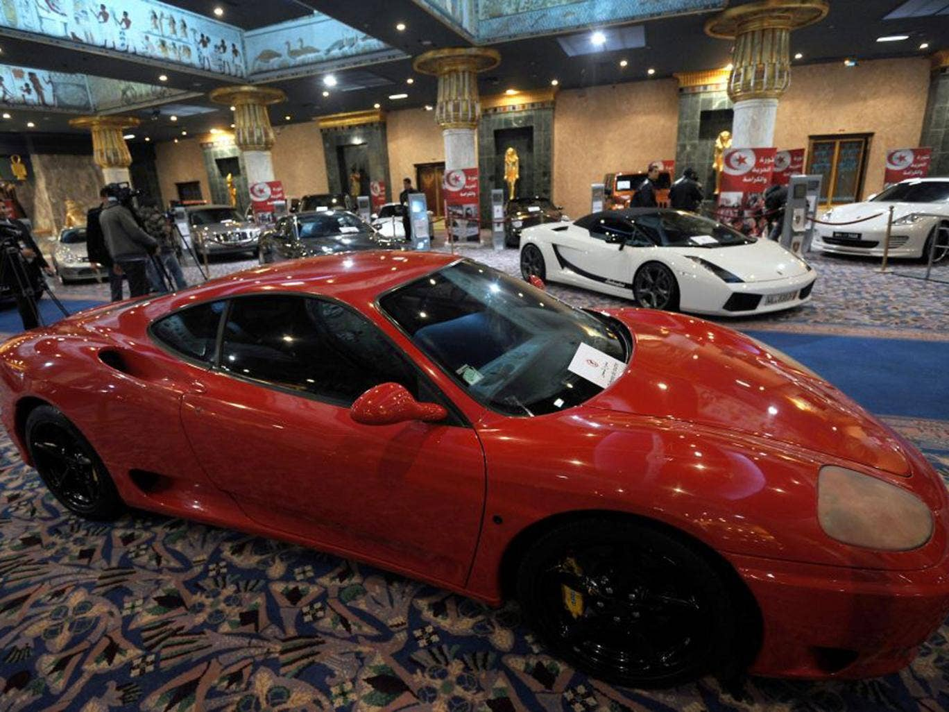 Luxury cars and a gilded falcon are among items from ousted Tunisian dictator Ben Ali and his family's treasure chest on display in Tunis