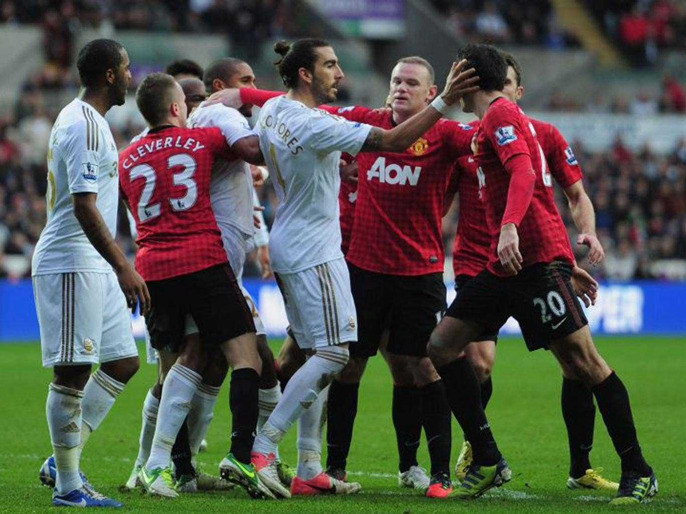 Robin van Persie (right) has to be held back from Ashley Williams (third left)
