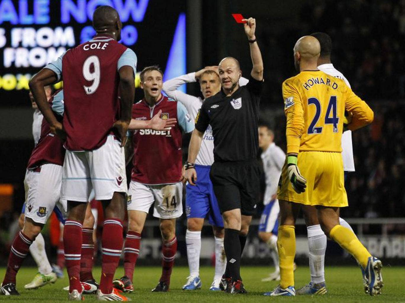 Carlton Cole is shown a red card by referee Anthony Taylor on Saturday