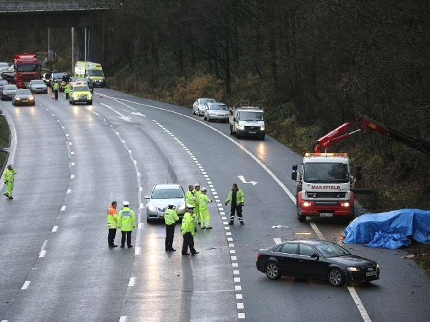 Police and emergency services attend the aftermath of a serious motor accident between Junctions 14 and 15 on the M6 motorway