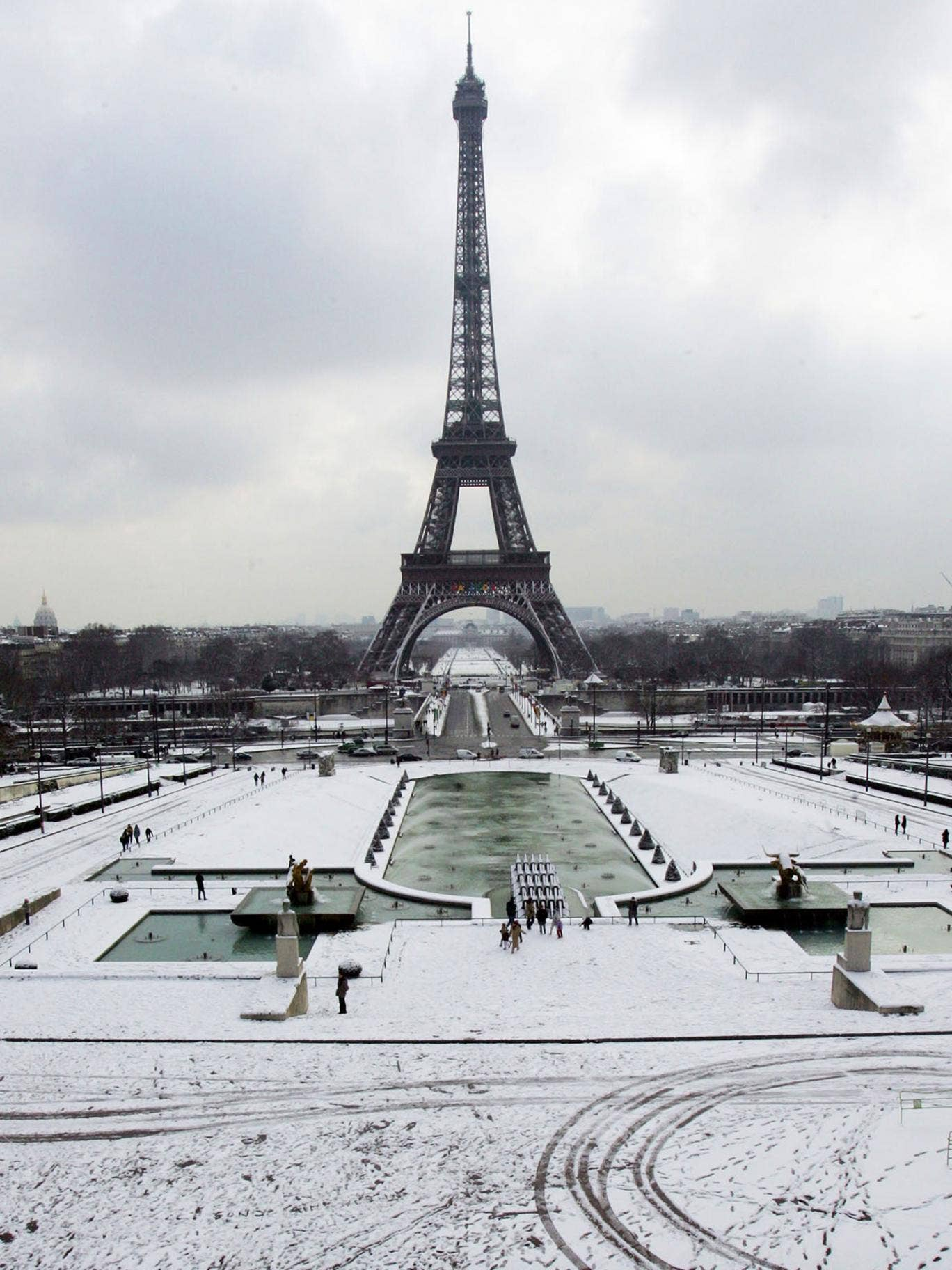 Snow covers the Trocadero gardens in front of the Eiffel Tower in Paris