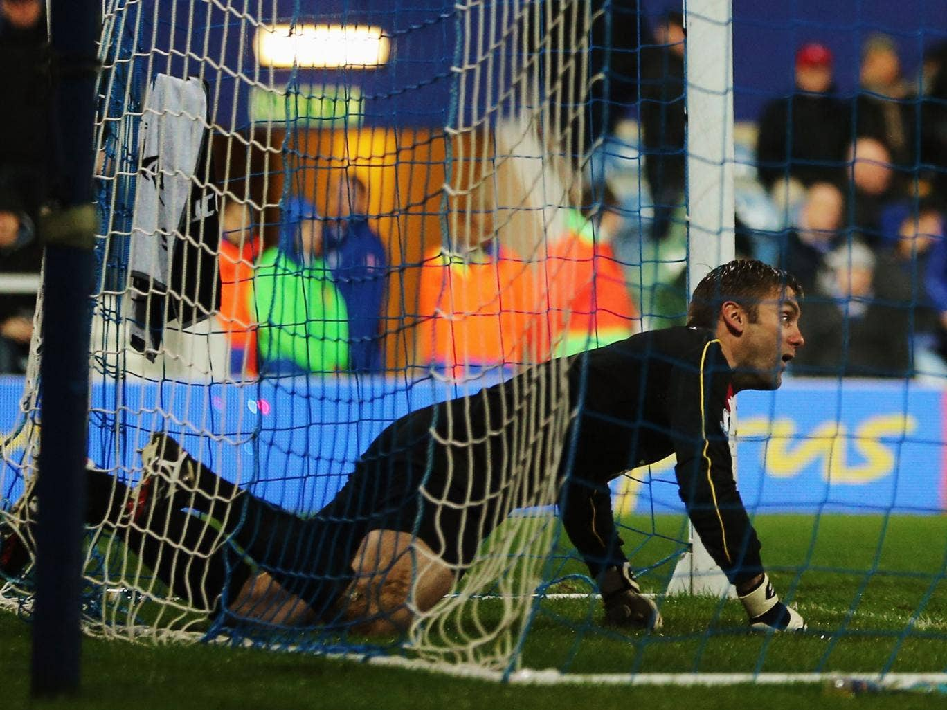 Robert Green reacts after putting the ball into his own net