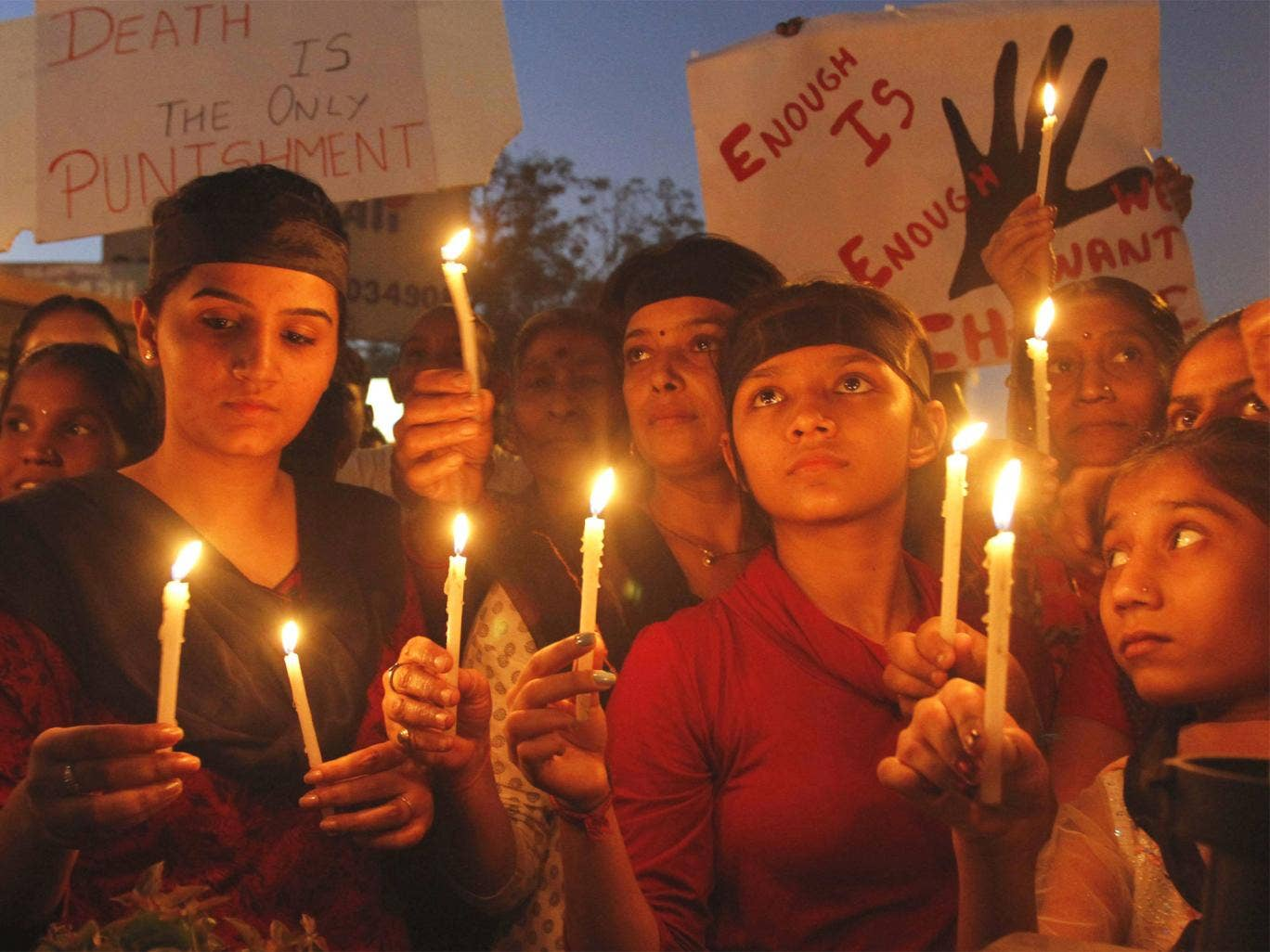 Indians holds candles to condemn the brutal gang-rape of a woman