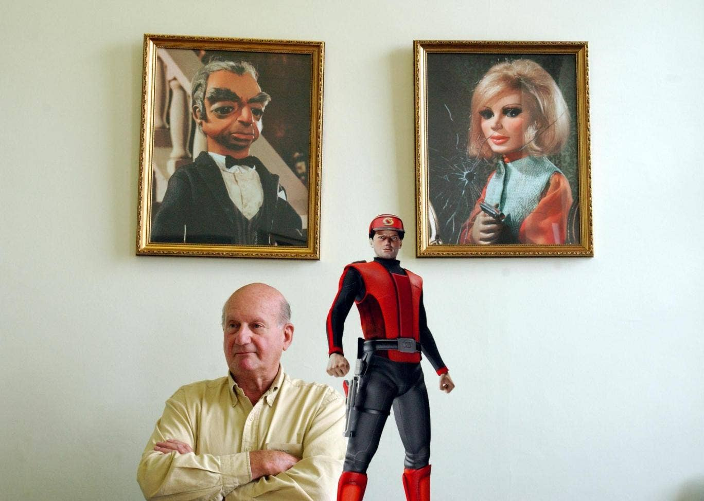 Anderson with three of his creations, Parker and Lady Penelope and, foreground, Captain Scarlet