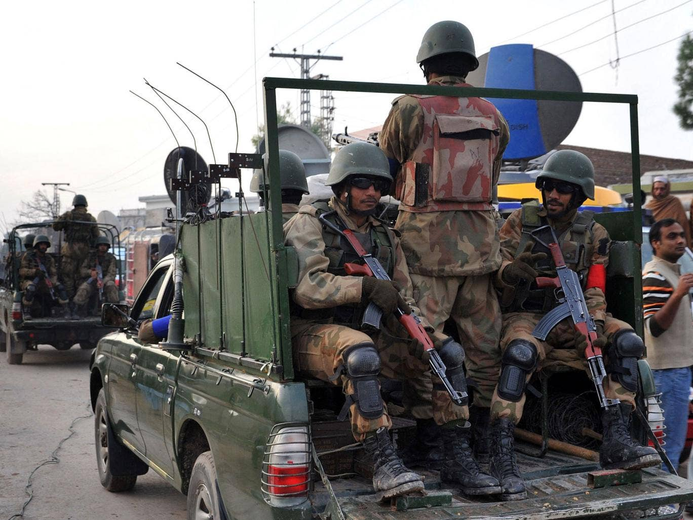 Pakistani army soldiers patrol outside the airport in Peshawar after the Pakistani Taliban claimed responsibility for suicide attack on an international airport earlier this month