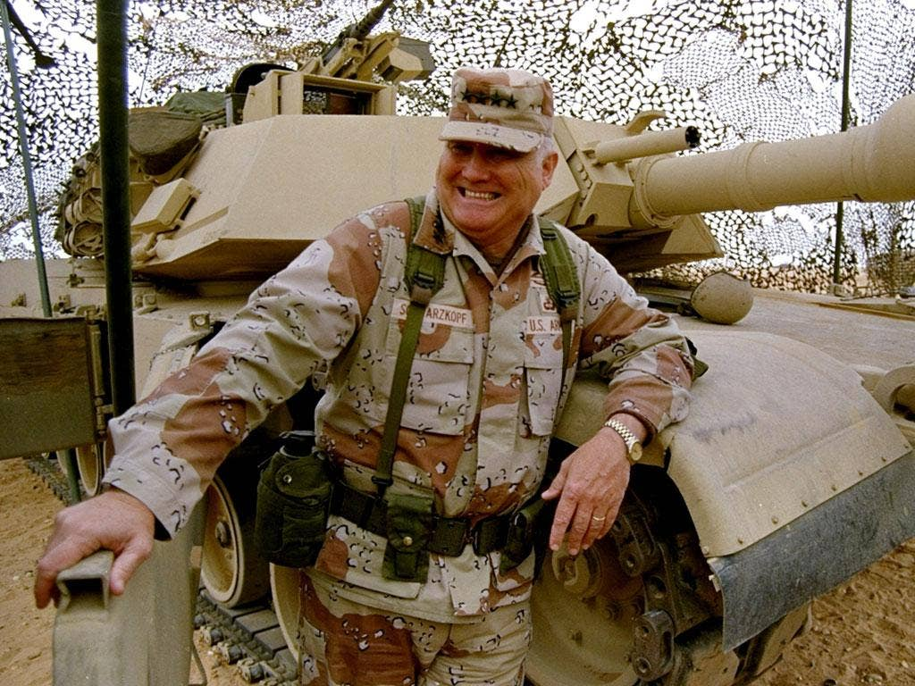 General H Norman Schwarzkopf stands at ease with his tank troops during Operation Desert Storm