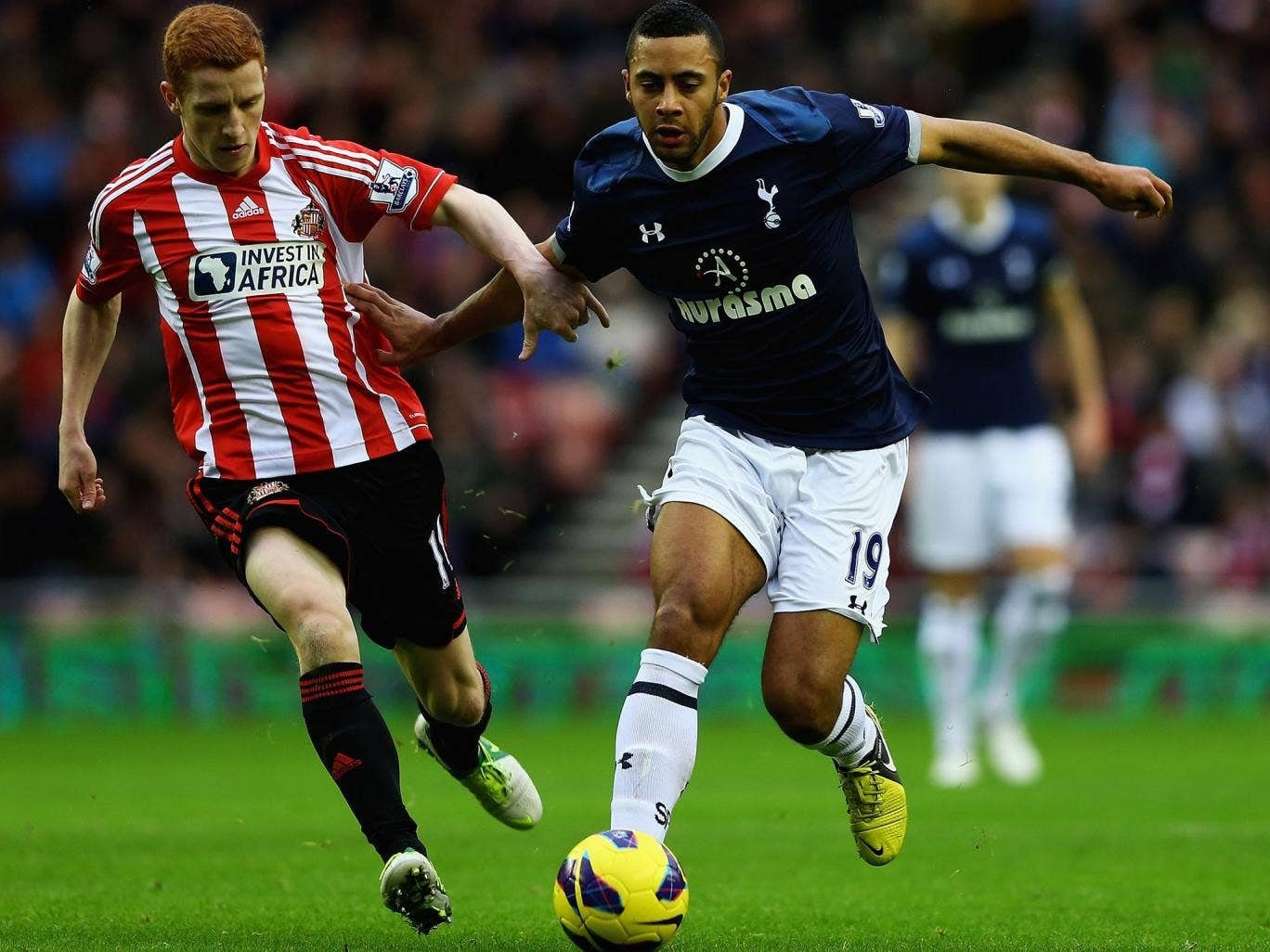 Moussa Dembele (right) holds off Sunderland's Jack Colback