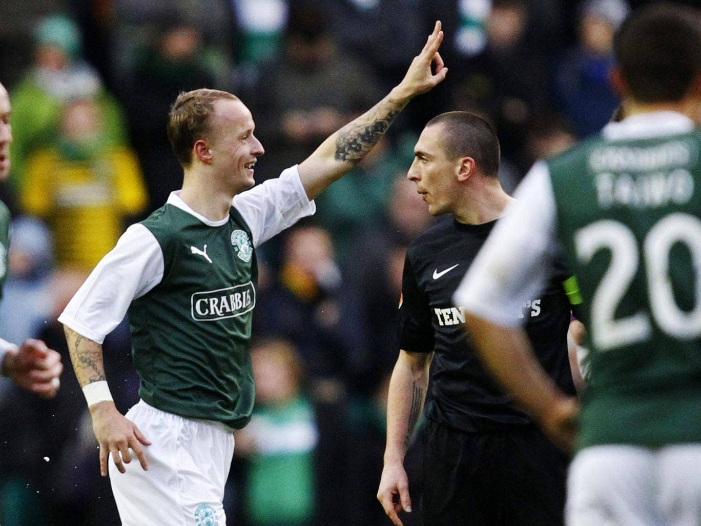 Green for go: Hibs' Leigh Griffiths celebrates his winner against Celtic