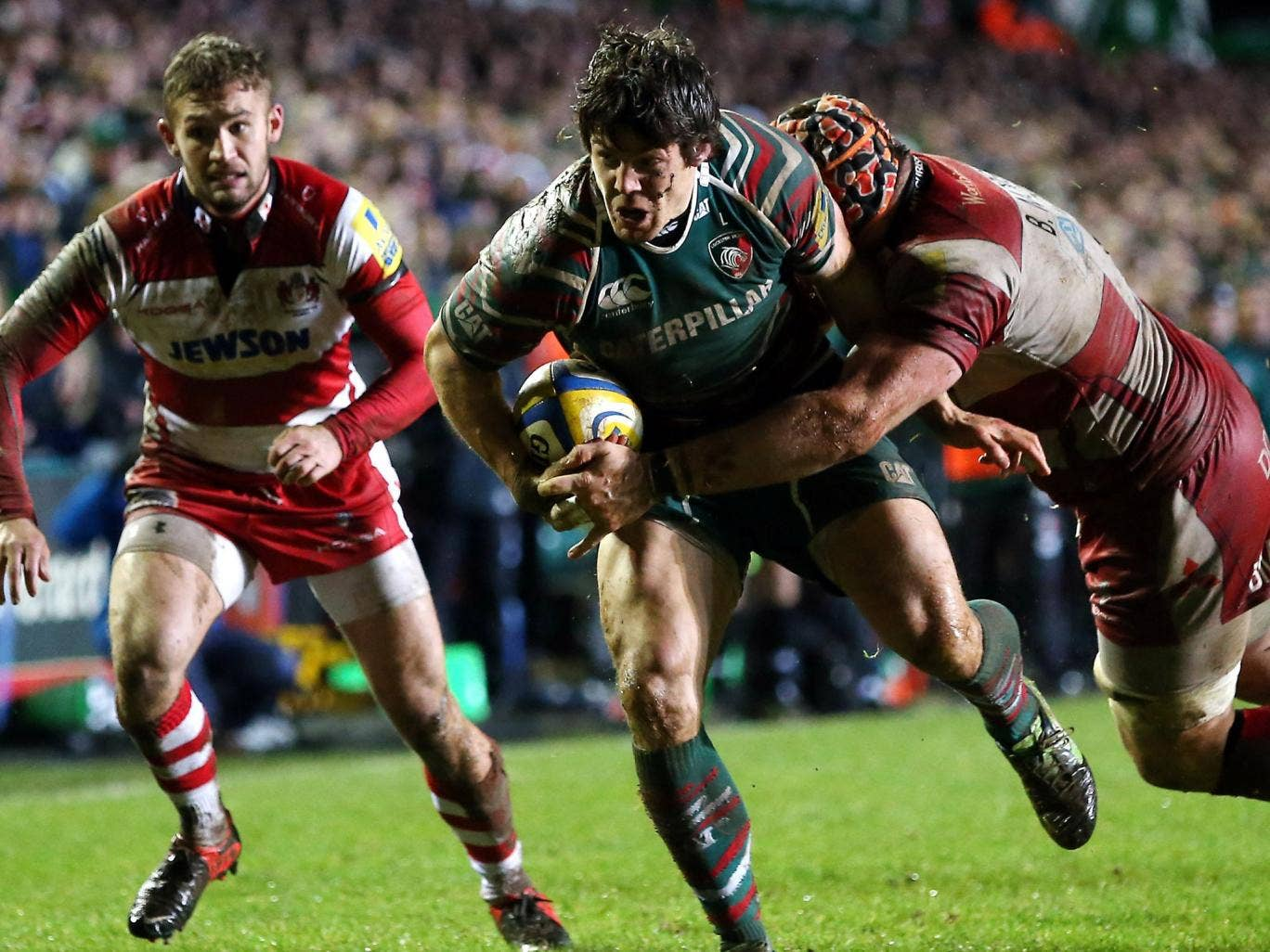 Strong-armed: Leicester's Anthony Allen is tackled by Ben Morgan
