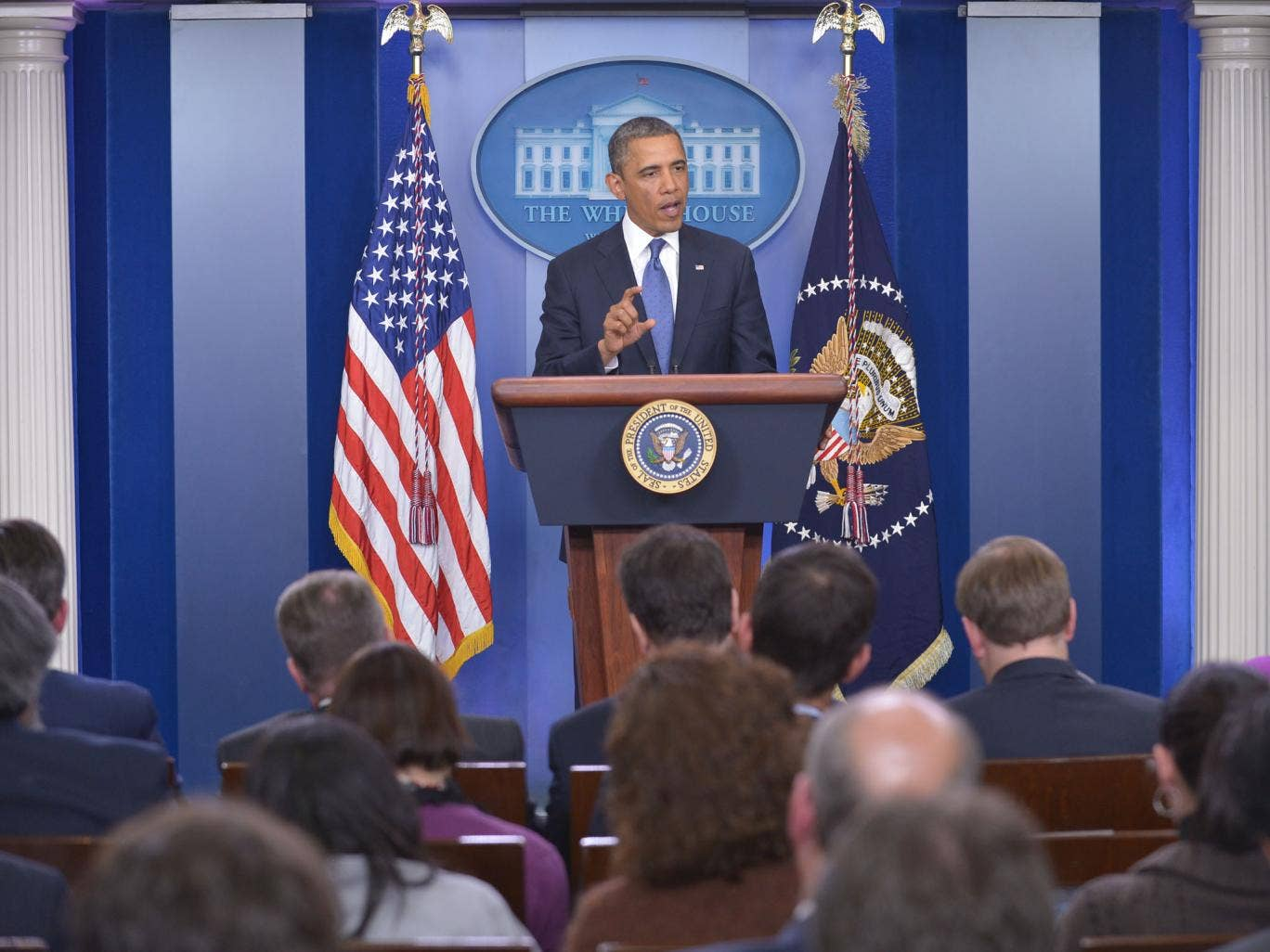 US President Barack Obama speaks following a meeting with congressional leaders in the Brady Briefing Room of the White House. Obama met with congressional leaders for talks aimed at avoiding the 'fiscal cliff'.