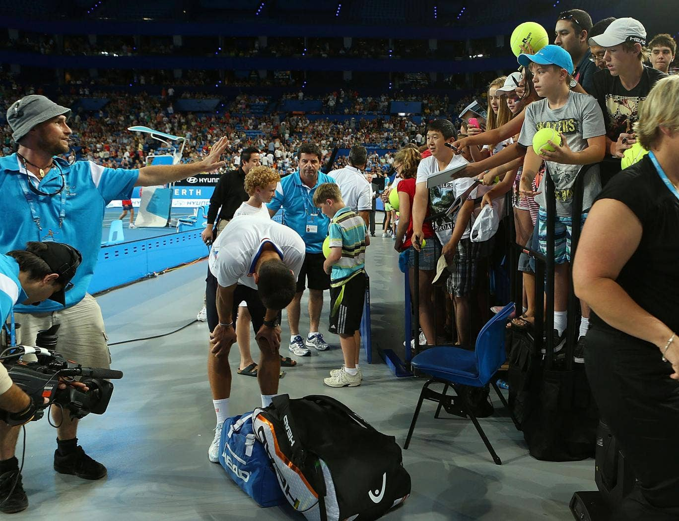 A group of young tennis enthusiasts injured Novak Djokovic as he was signing autographs at the Hopman Cup in Perth