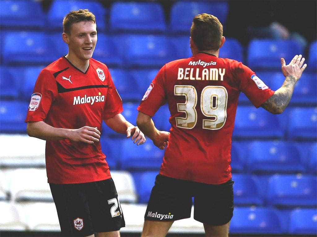 Joe Mason celebrates his winner for Cardiff with Craig Bellamy