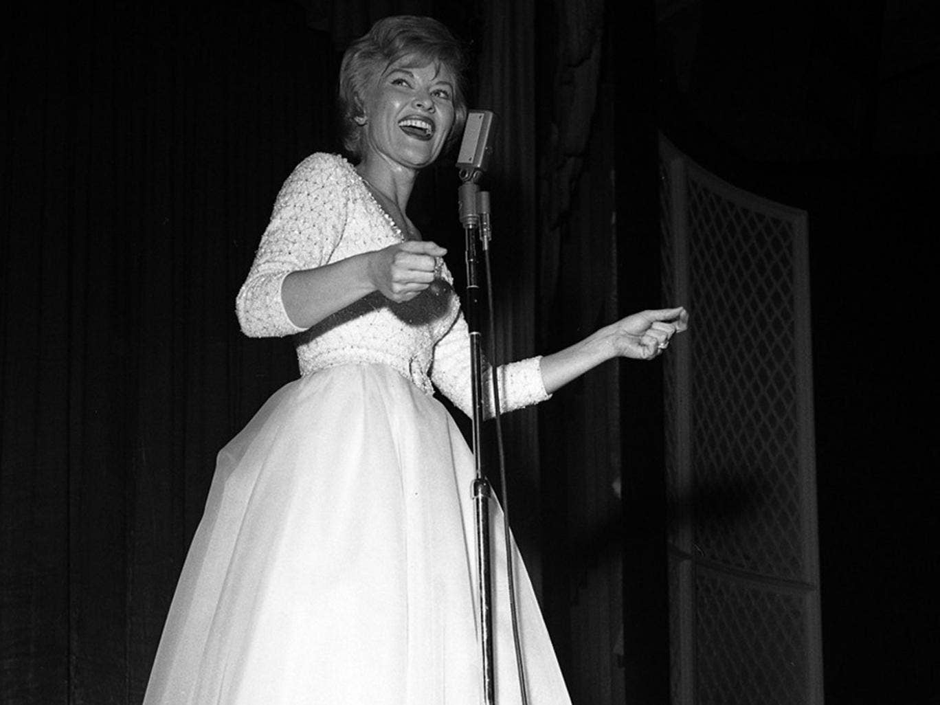 Page performs at The Dunes Hotel, Las Vegas, in 1962