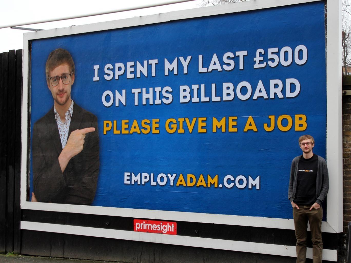Adam Pacitti with the billboard in Camden