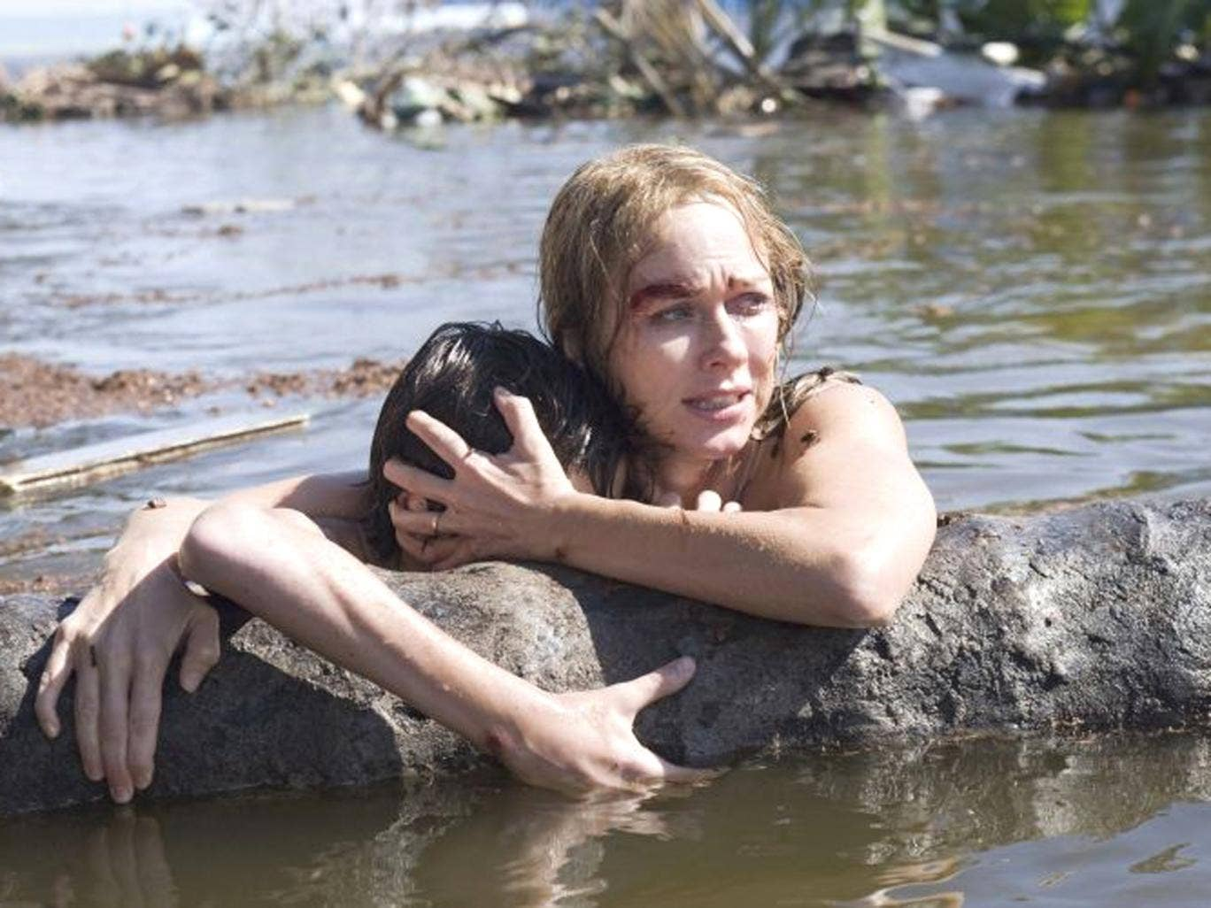 Fight for survival: Tom Holland and Naomi Watts battle against the odds as mother and son in 'The Impossible'