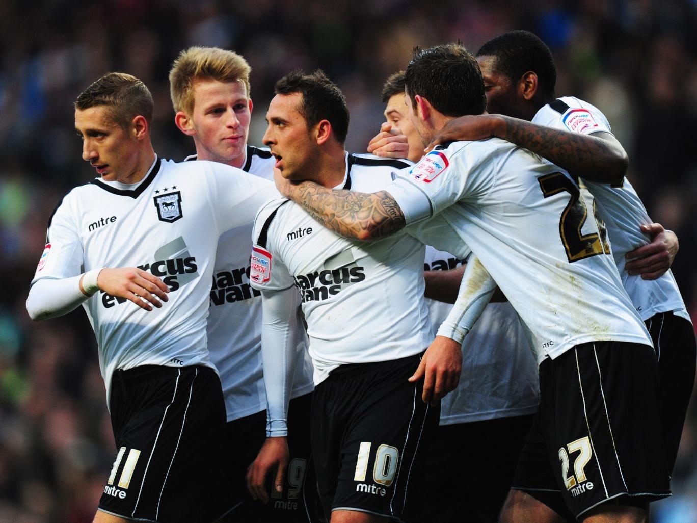 Michael Chopra (C) of Ipswich Town celebrates with team mates