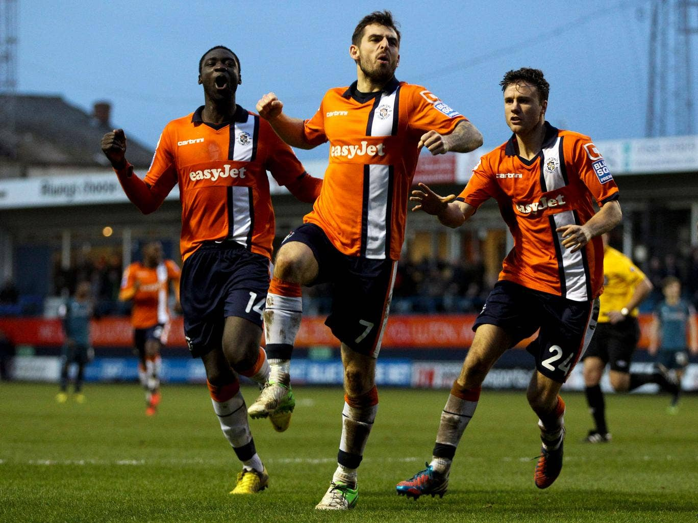 Alex Lawless of Luton celebrates after scoring the opening goal