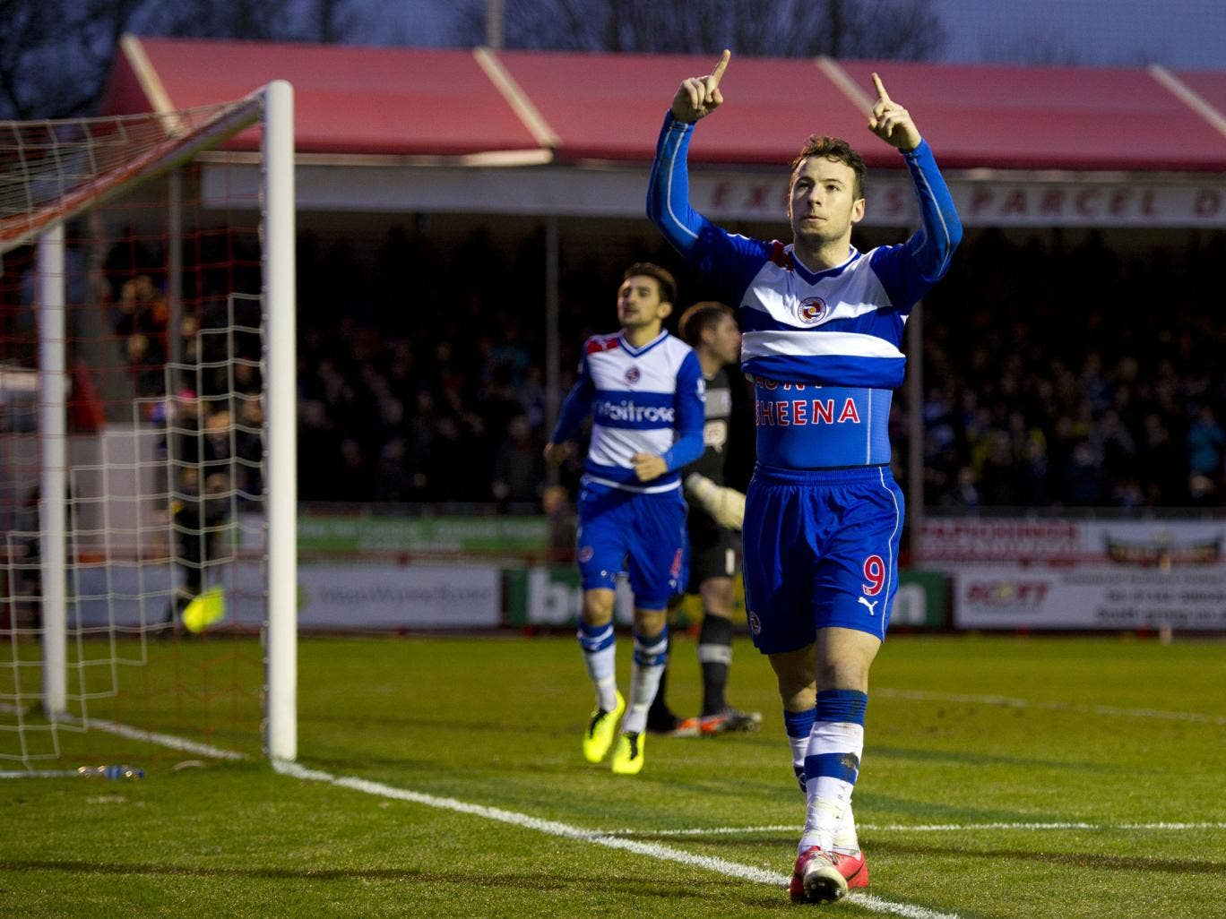 Reading's English striker Adam Le Fondre celebrates scoring a penalty