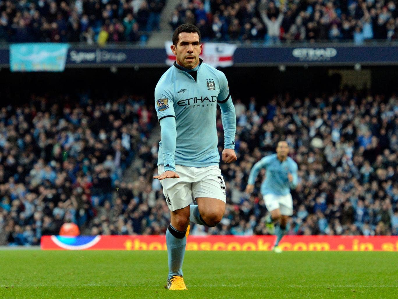Manchester City's Argentinian striker Carlos Tevez celebrates scoring from a free kick