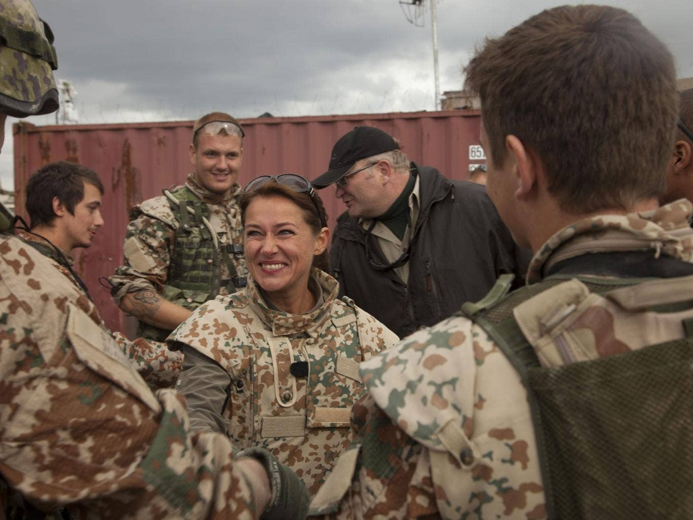 Sidse Babett Knudsen, centre, as Denmark's PM Birgitte Nyborg Christensen, with Danish soldiers in Afghanistan