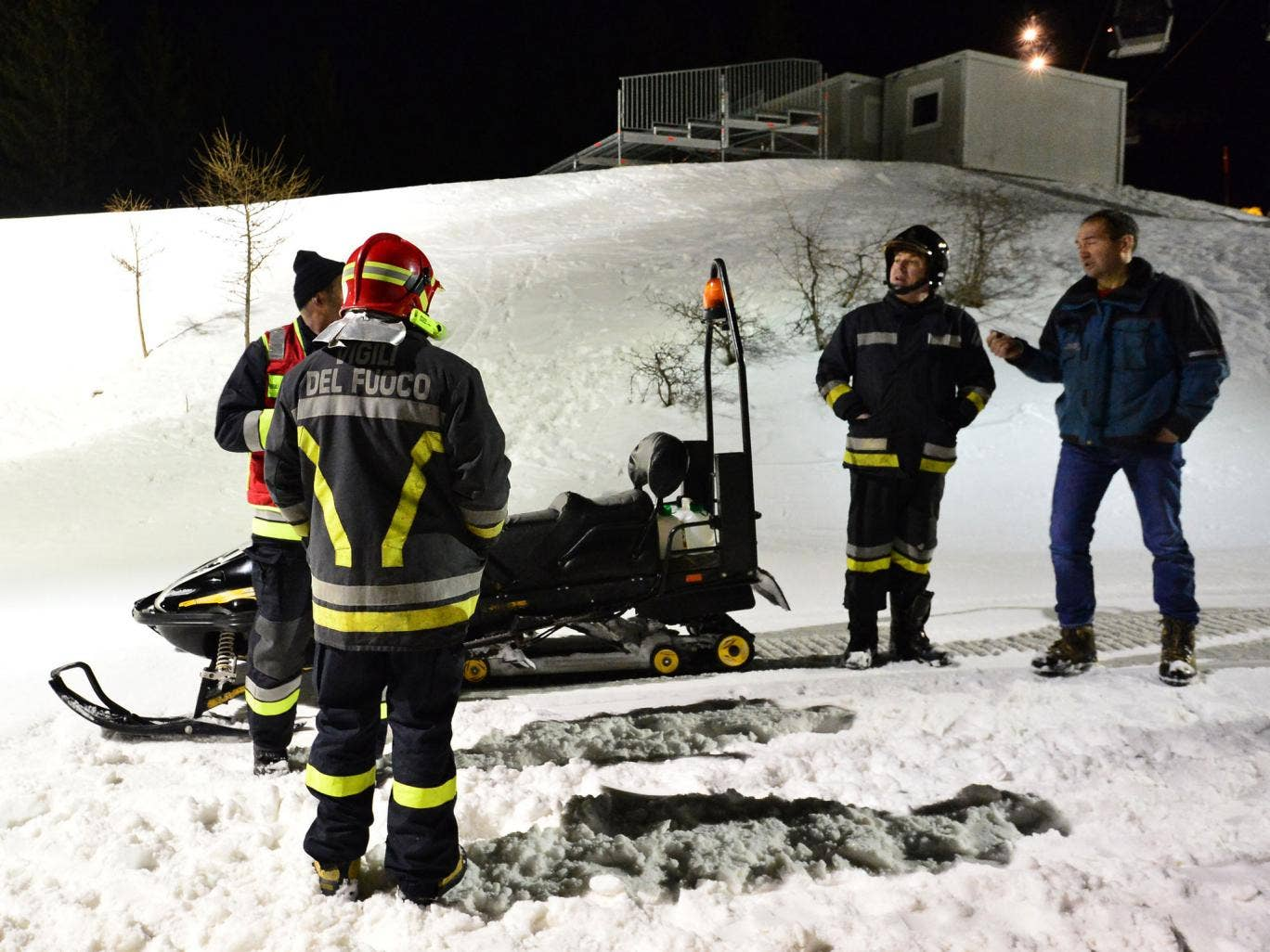 Rescuers on Mount Cermis, where the accident occurred