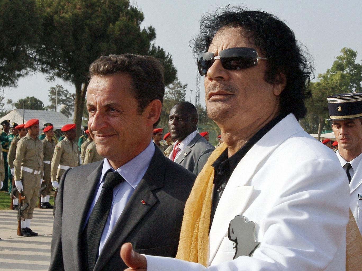 Nicolas Sarkozy is welcomed to Libya by Muammar Gaddafi in 2007