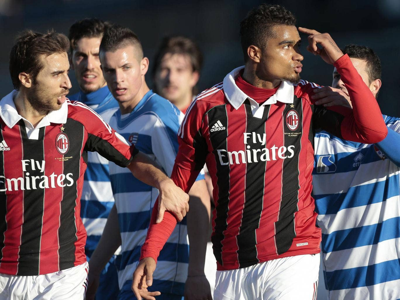 Walk-off part: An angry Kevin-Prince Boateng of Milan (right) leaves the field in response to the racist abuse