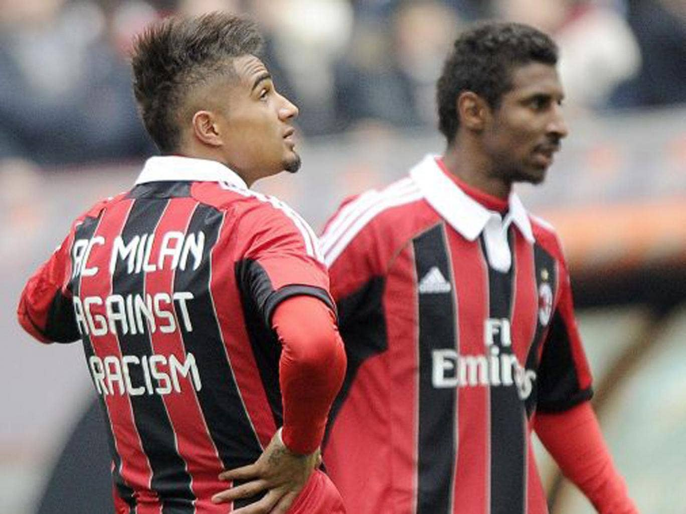 Milan's Kevin-Prince Boateng (left) and Kevin Constant wear  anti-racism shirts before their game against Siena yesterday