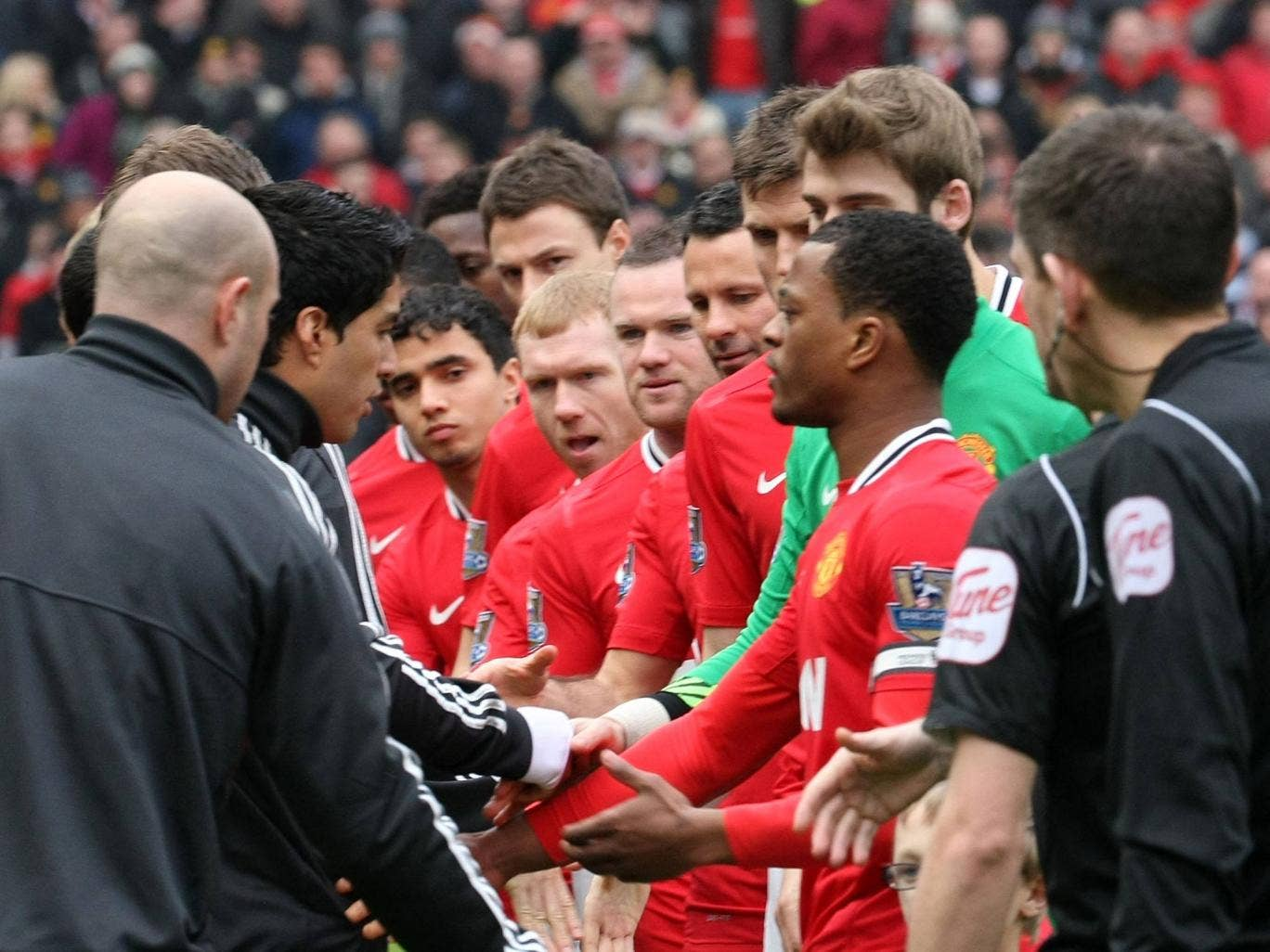 <b>February 2012:</b> United and Liverpool met again at Old Trafford, but more controversy followed as Suarez refused to shake Evra's hand before kick-off.