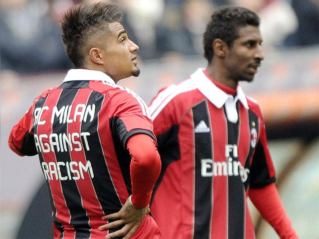 AC Milan's Kevin-Prince Boateng, left, was racially abused