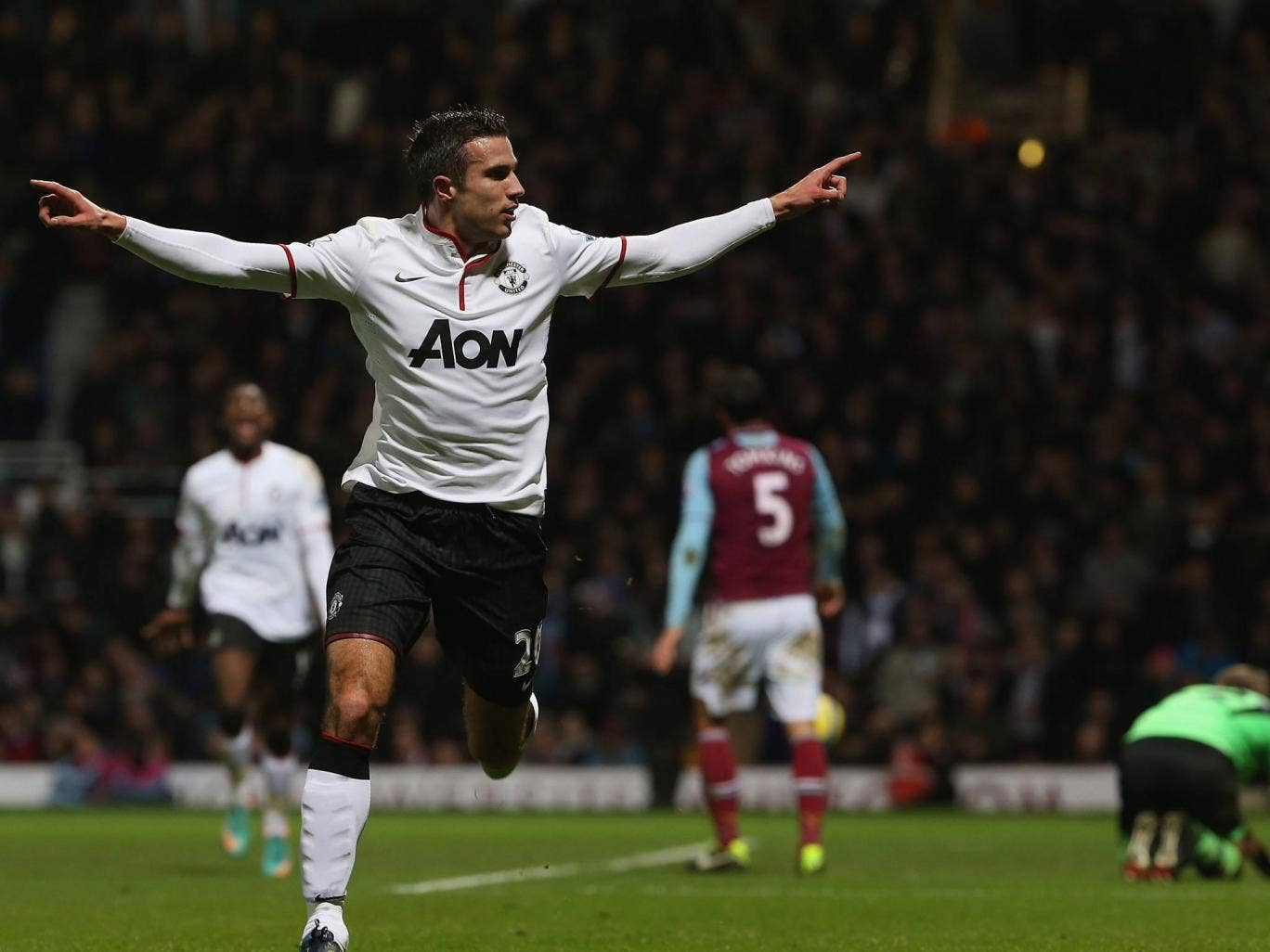 Robin van Persie celebrates his late equaliser against West Ham in the FA Cup