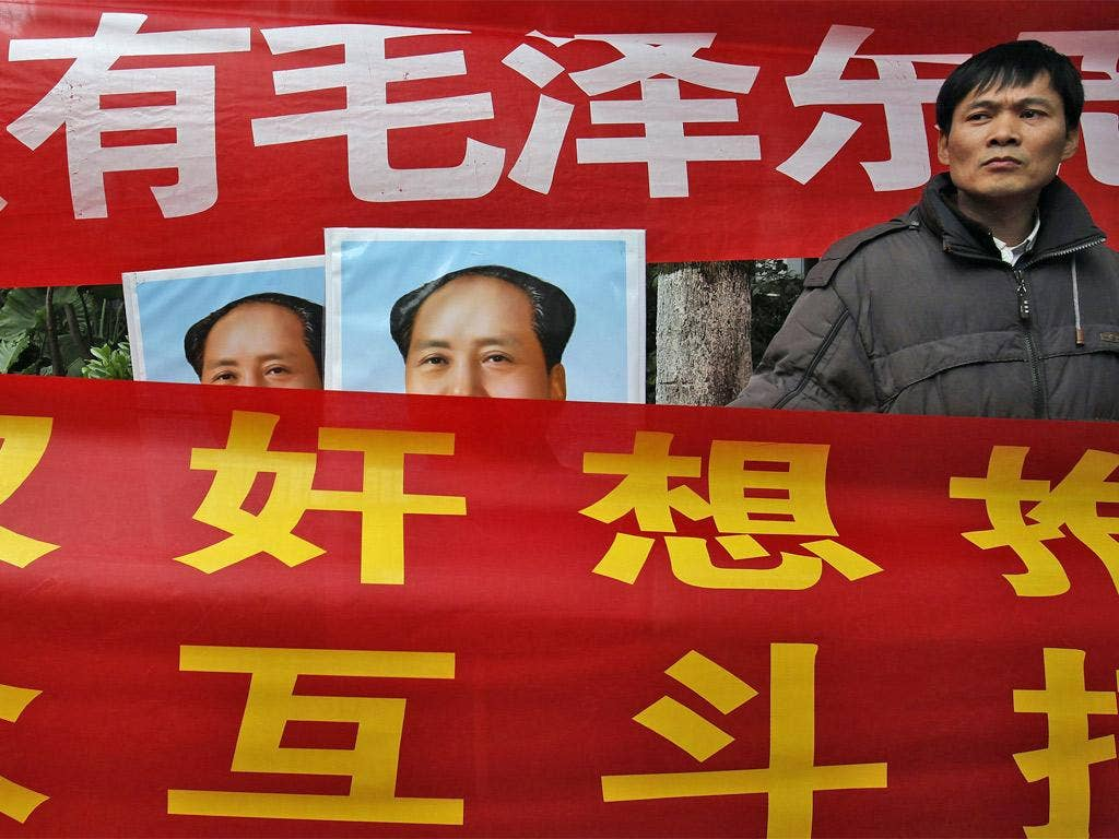 Leftists displaying banners and portraits of the late Chinese leader
