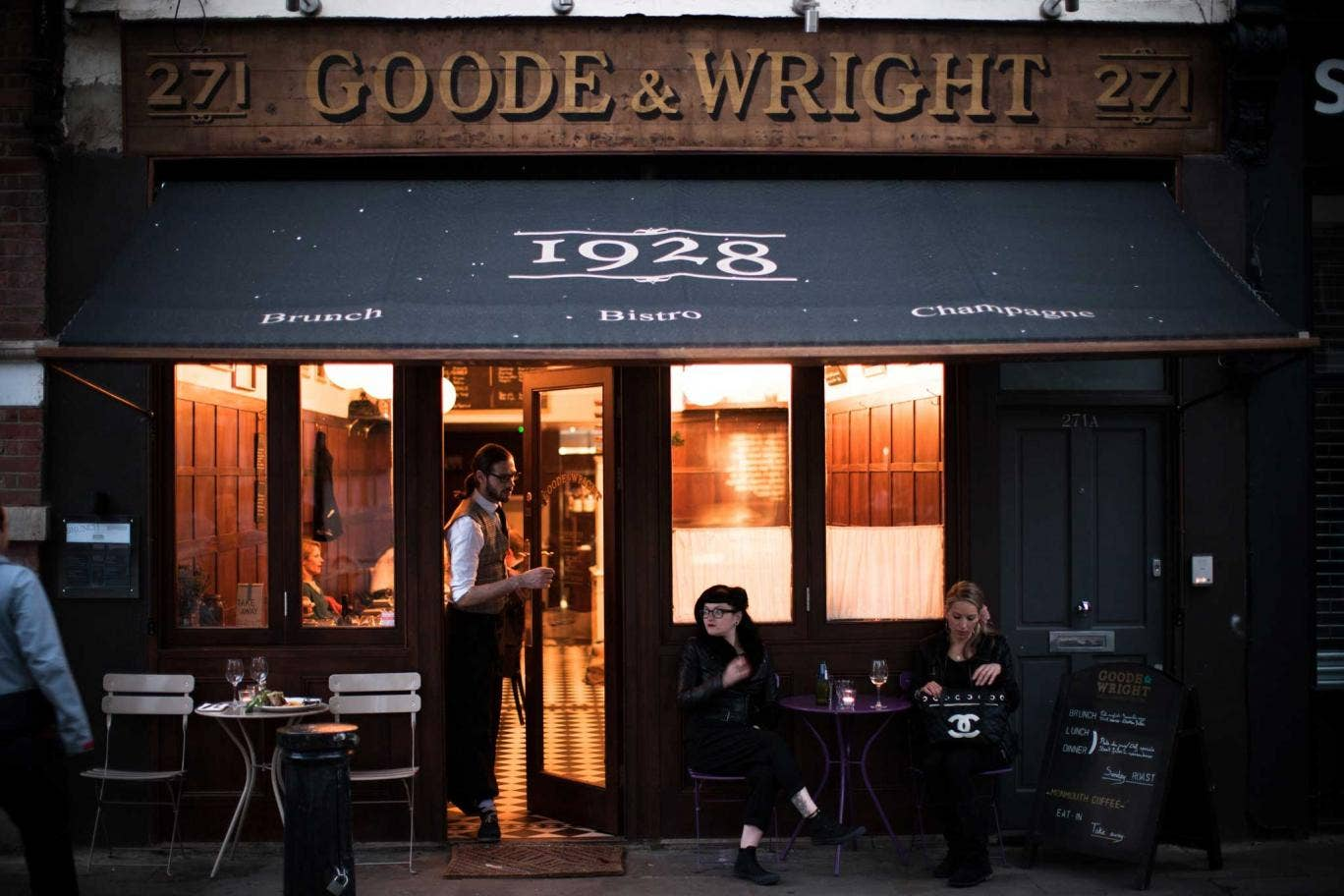 Goode & Wright is starkly designed with wood-panelled walls, dangling globe lights and half-curtained windows