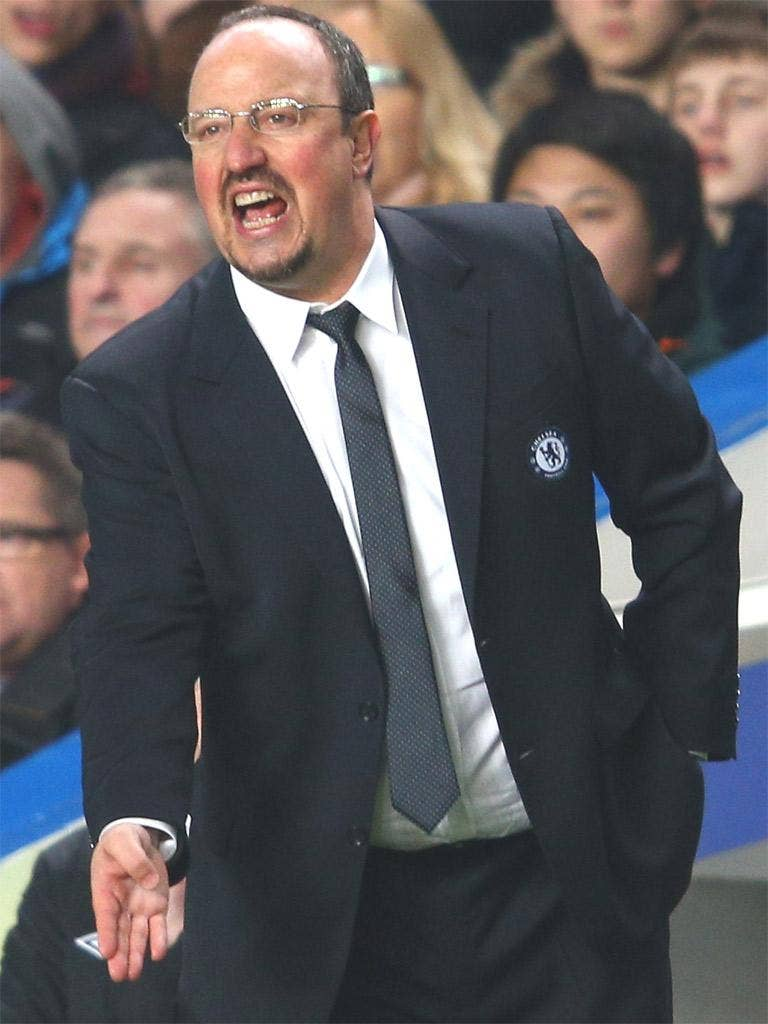 Rafael Benitez gives instructions during the Capital One Cup Semi-Final first leg match between Chelsea and Swansea City