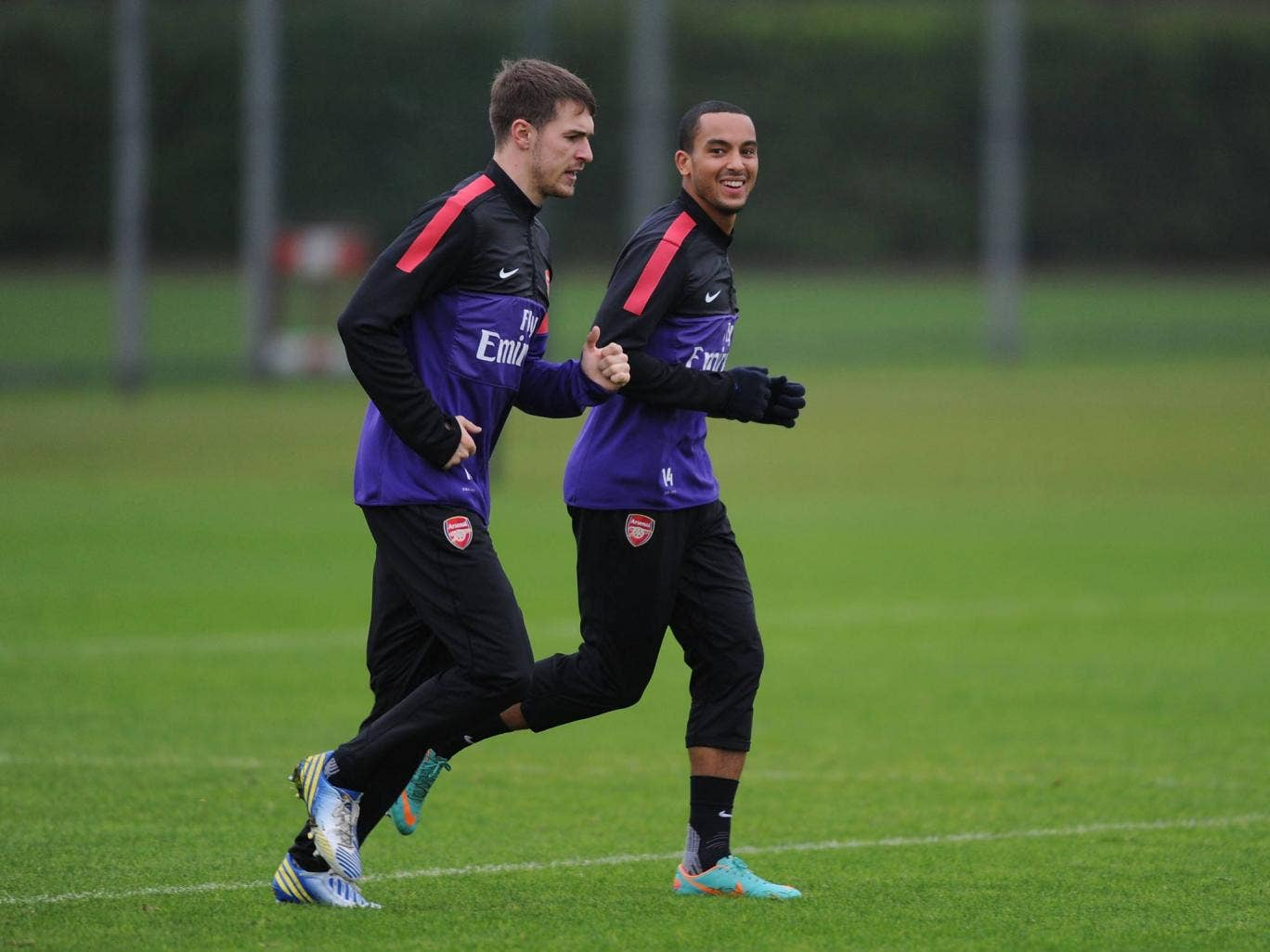 Aaron Ramsey trains with Theo Walcott