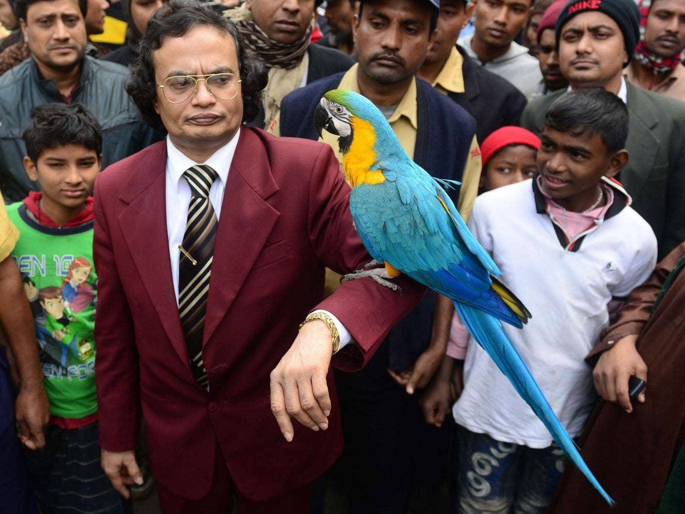 Parrot owner Abdul Wadud poses with Princess the macaw, who has refused to eat since being separated from her partner