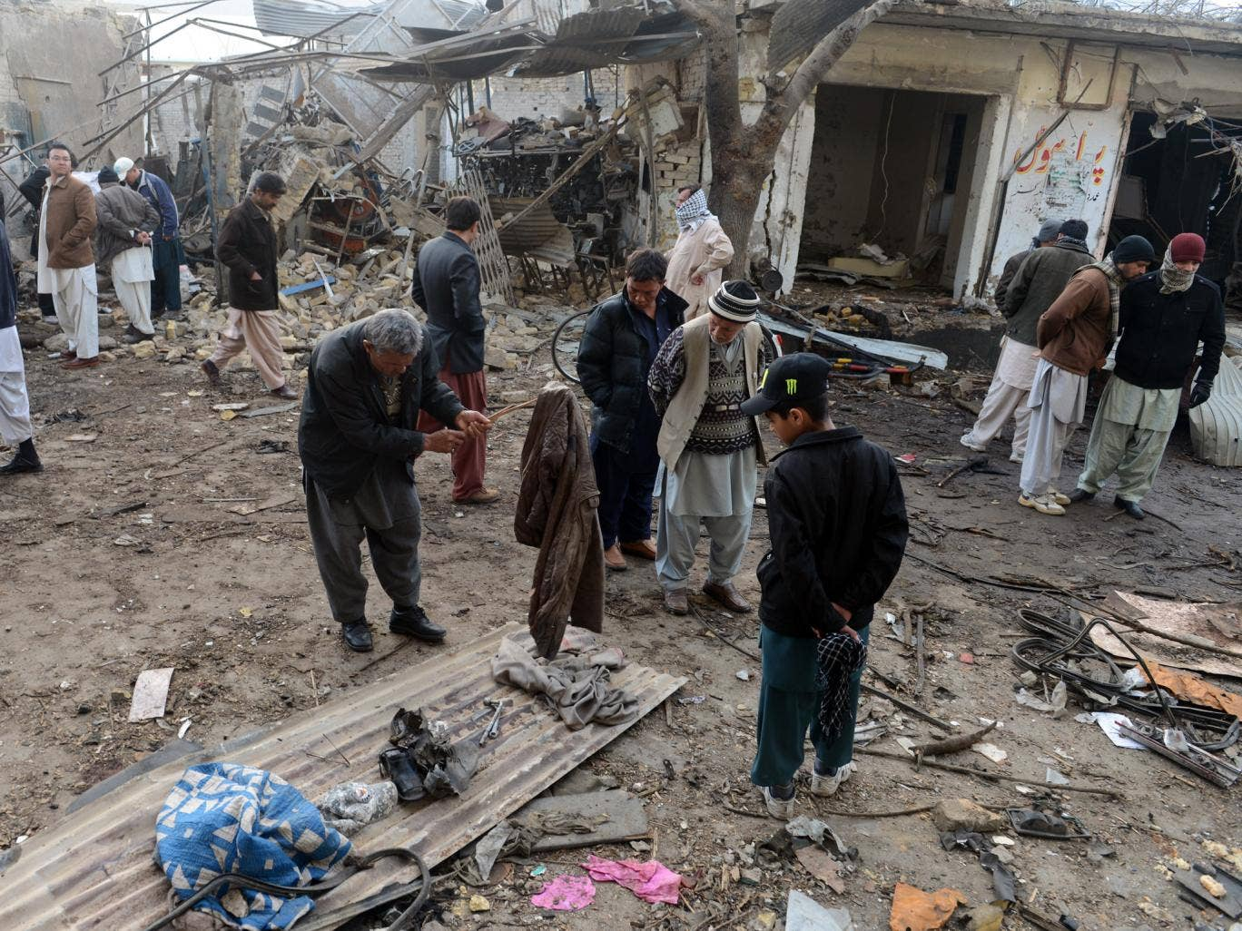 Residents gather at the site of bombings in Quetta