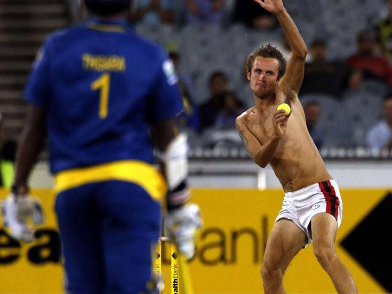 An underdressed spectator fancies a bowl in Melbourne