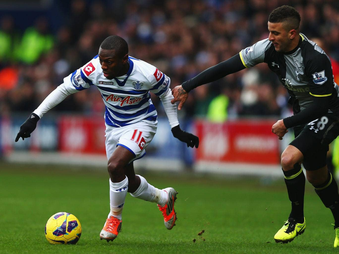 Shaun Wright-Phillips of QPR and Kyle Naughton of Tottenham  in action at Loftus Road