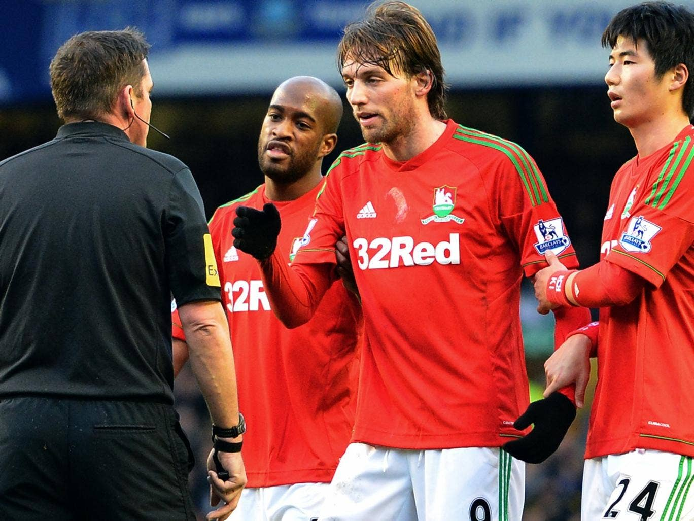 Michu (centre) had a comparatively quiet game