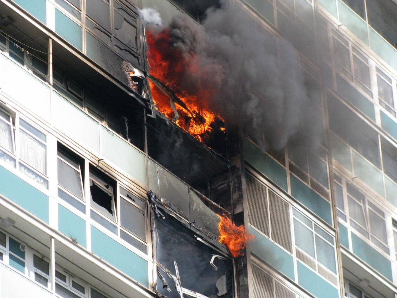 Tragedy: Lakanal House in the Sceaux Gardens estate in Camberwell, south London, which caught fire in July 2009, killing six people