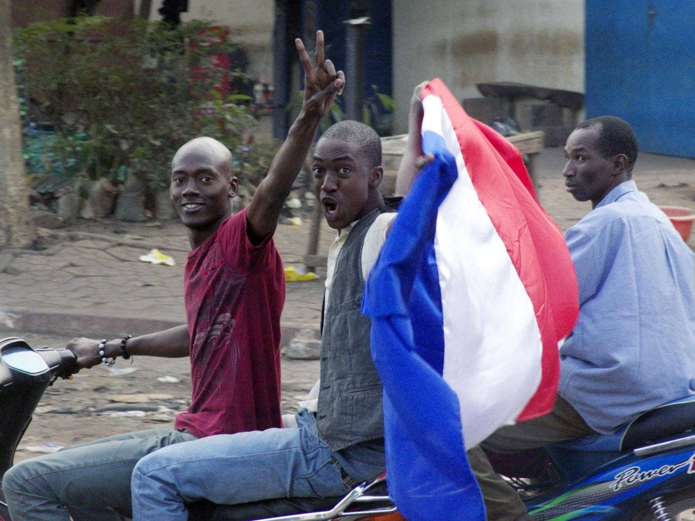 Inhabitants of Bamako, the capital of Mali, wave a French flag following the military intervention