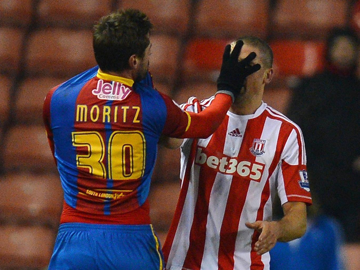 Crystal Palace's midfielder Andre Moritz confronts Stoke City forward Jon Walters