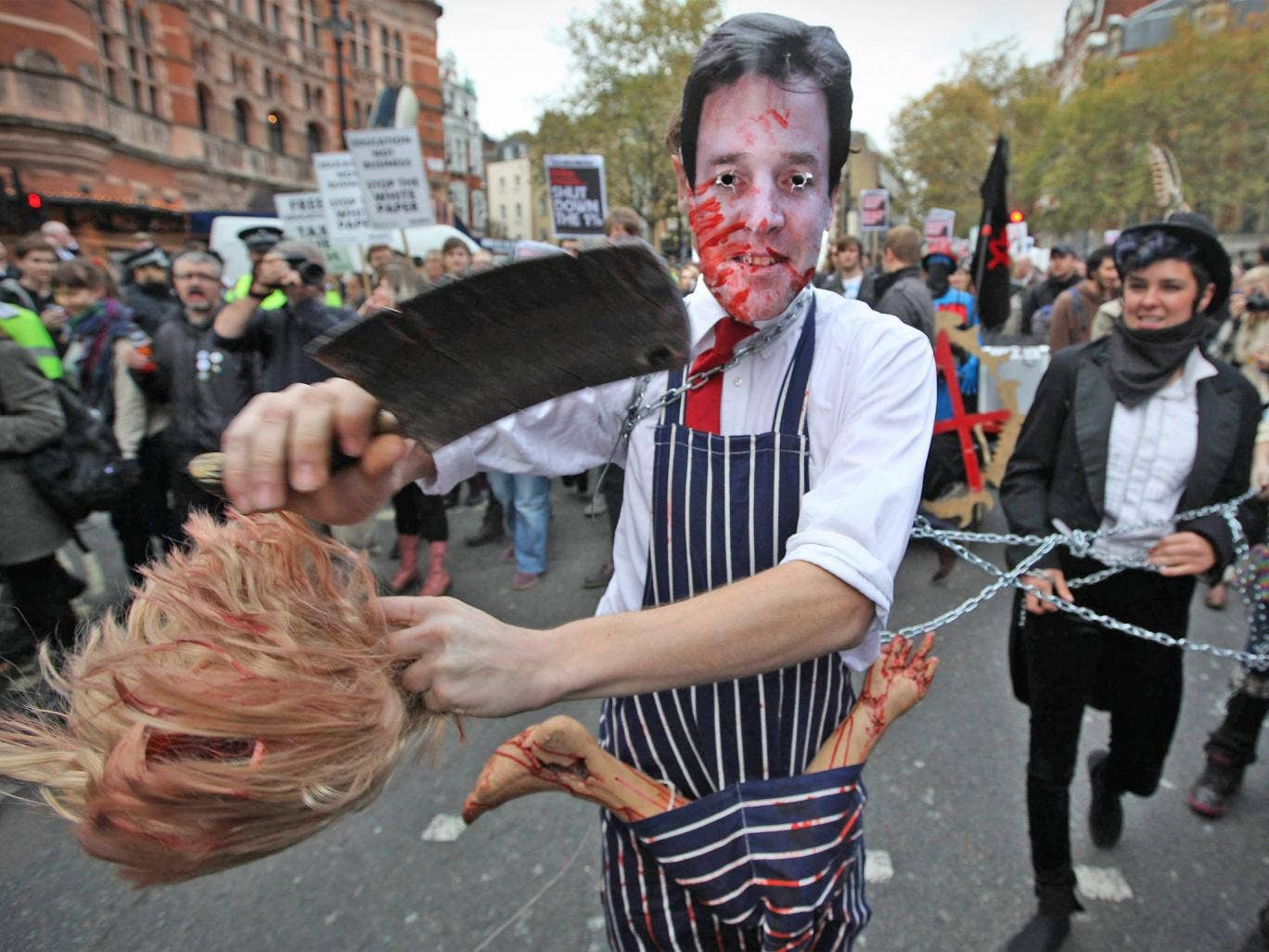A student in a Nick Clegg mask protests against higher tuition fees in London in 2011