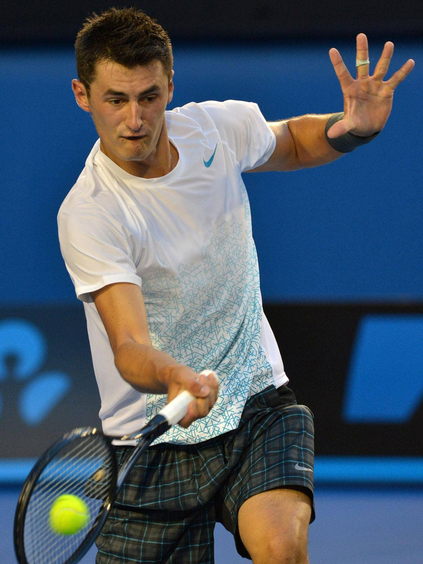 Moment of strewth: Bernard Tomic, the only remaining home player in the Australian Open singles, was beaten in straight sets by Roger Federer